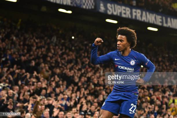 TOPSHOT Chelsea's Brazilian midfielder Willian celebrates after scoring their second goal during the first leg of the UEFA Europa League round of 16...