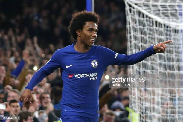 Chelsea's Brazilian midfielder Willian celebrates after scoring their second goal during the English League Cup fourth round football match between...