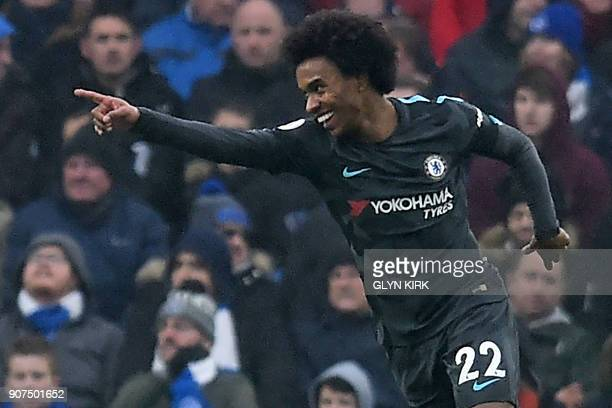 Chelsea's Brazilian midfielder Willian celebrates after scoring their second goal during the English Premier League football match between Brighton...