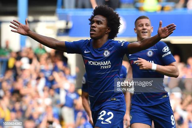 Chelsea's Brazilian midfielder Willian celebrates scoring his team's fourth goal during the English Premier League football match between Chelsea and...