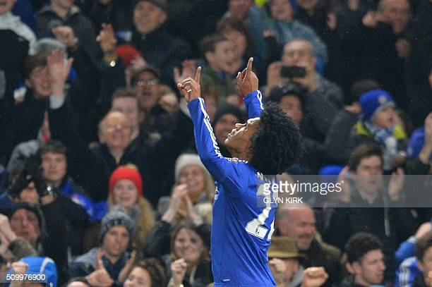 Chelsea's Brazilian midfielder Willian celebrates scoring his team's third goal during the English Premier League football match between Chelsea and...