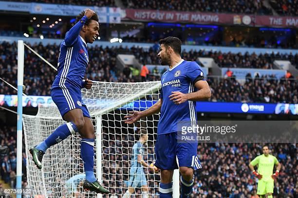 Chelsea's Brazilian midfielder Willian celebrates scoring his team's second goal with Chelsea's Brazilianborn Spanish striker Diego Costa during the...