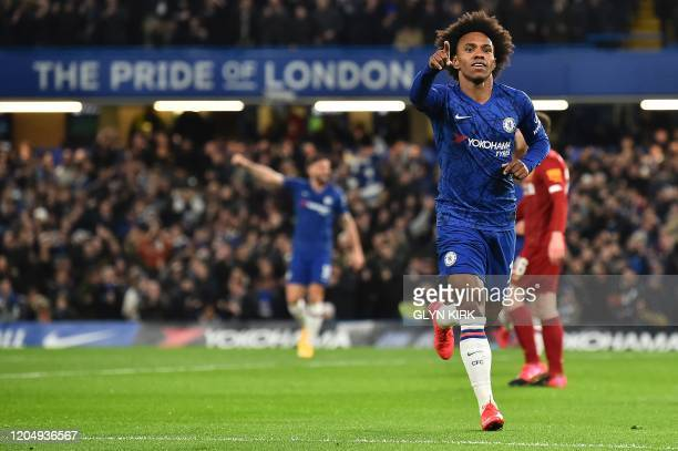 Chelsea's Brazilian midfielder Willian celebrates scoring the opening goalduring the English FA Cup fifth round football match between Chelsea and...
