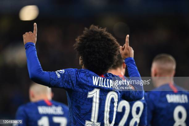 Chelsea's Brazilian midfielder Willian celebrates scoring the opening goal during the English FA Cup fifth round football match between Chelsea and...