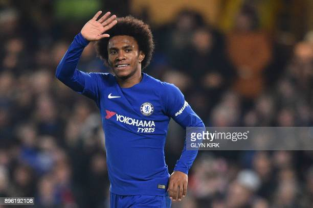 Chelsea's Brazilian midfielder Willian celebrates scoring the team's first goal during the English League Cup quarterfinal football match between...