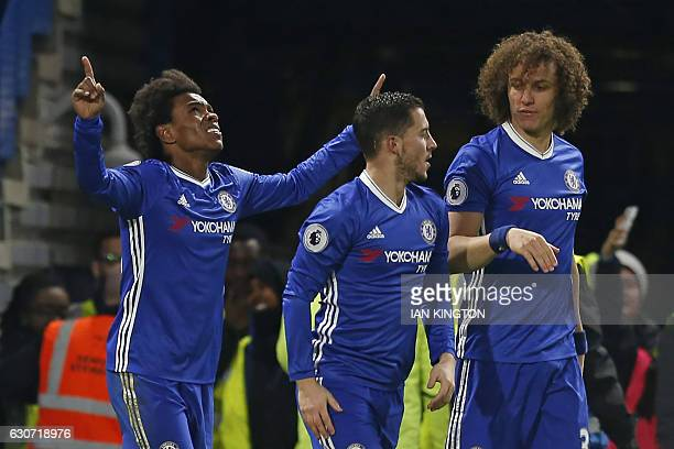 Chelsea's Brazilian midfielder Willian celebrates with teammates after scoring their second goal during the English Premier League football match...