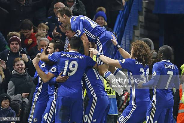 Chelsea's Brazilian midfielder Willian celebrates with teammates after scoring their third goal during the English Premier League football match...