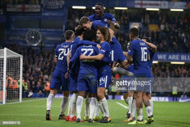 Chelsea's Brazilian midfielder Willian celebrates with teammates after scoring their second goal during the English League Cup fourth round football...