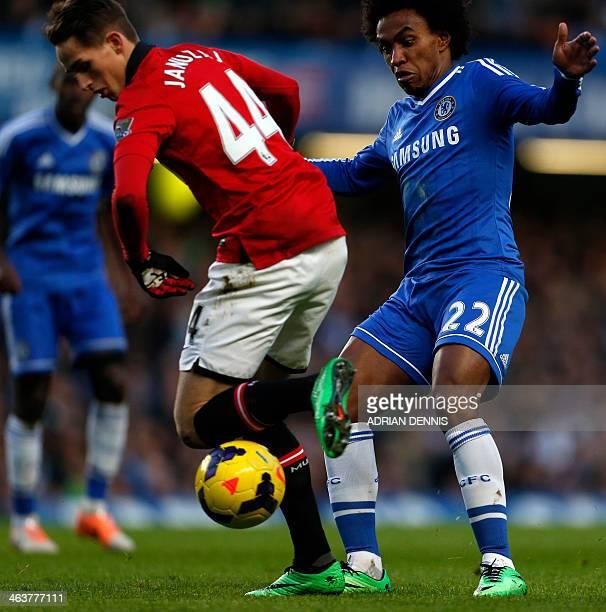Chelsea's Brazilian midfielder Willian closes in on Manchester United's Belgian midfielder Adnan Januzaj during the English Premier League football...