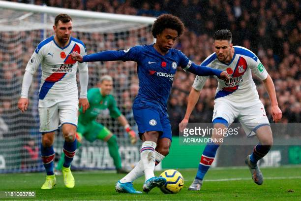 Chelsea's Brazilian midfielder Willian controls the ball during the English Premier League football match between Chelsea and Crystal Palace at...