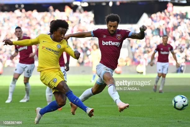 Chelsea's Brazilian midfielder Willian crosses the ball as West Ham United's Brazilian midfielder Felipe Anderson closes in during the English...