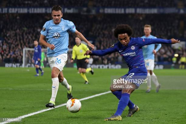 Chelsea's Brazilian midfielder Willian crosses the ball during the UEFA Europa League round of 32 2nd leg football match between Chelsea and Malmo at...