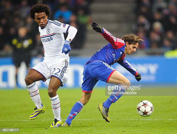 Chelsea's Brazilian midfielder Willian eyes the ball controlled by Basel's Swiss defender Kay Voser during the UEFA Champions League group E football...