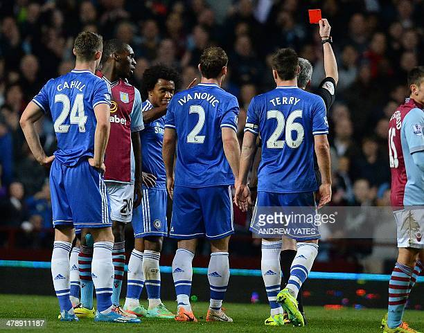 Chelsea's Brazilian midfielder Willian is shown a red card by referee Chris Foy during the English Premier League football match between Aston Villa...