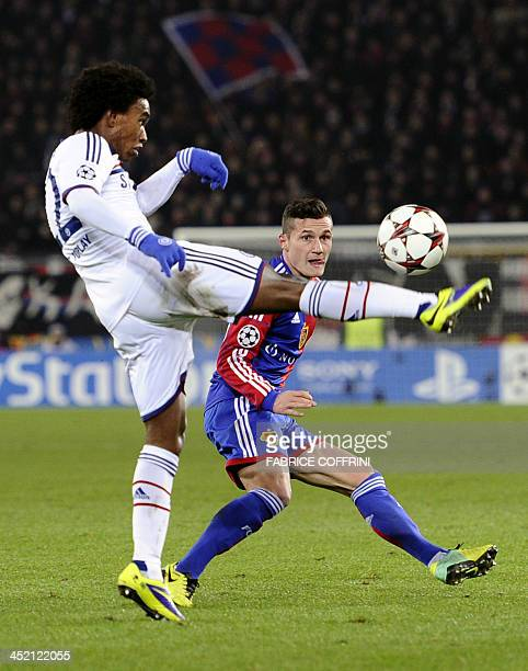 Chelsea's Brazilian midfielder Willian kicks the ball next to Basel's Swiss midfielder Taulant Xhaka during the UEFA Champions League group E...