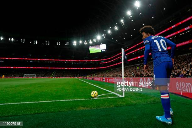 Chelsea's Brazilian midfielder Willian prepares to take a corner during the English Premier League football match between Tottenham Hotspur and...