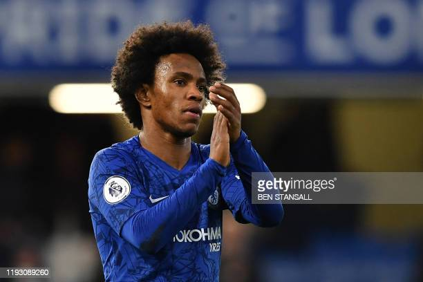 Chelsea's Brazilian midfielder Willian reacts at the final whistle during the English Premier League football match between Chelsea and Burnley at...