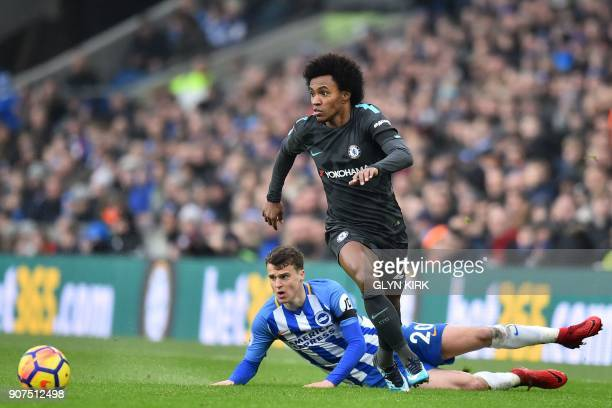 Chelsea's Brazilian midfielder Willian runs away from Brighton's English midfielder Solly March during the English Premier League football match...
