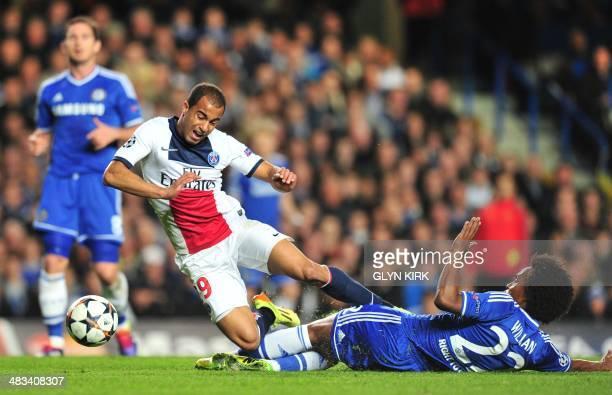 Chelsea's Brazilian midfielder Willian tackles Paris' Brazilian forward Lucas Moura during the UEFA Champions League quarter final second leg...