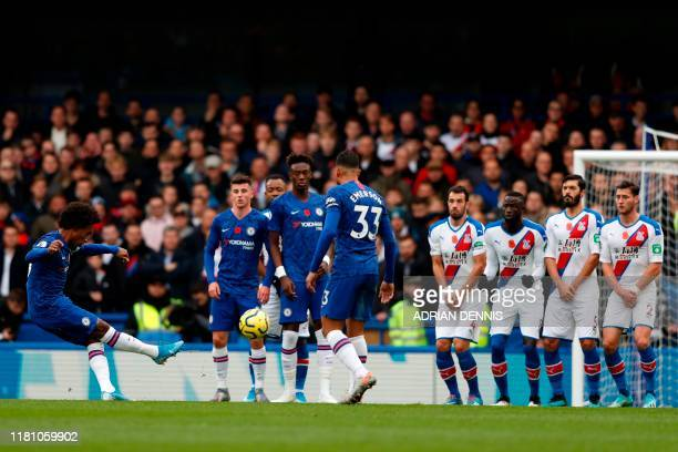 Chelsea's Brazilian midfielder Willian takes a free kick during the English Premier League football match between Chelsea and Crystal Palace at...