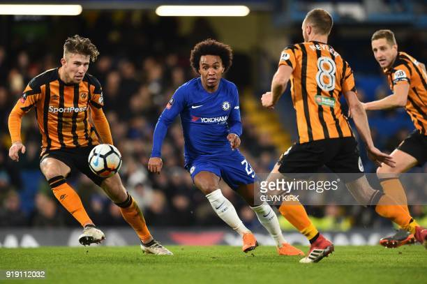 Chelsea's Brazilian midfielder Willian takes it past Hull City's English defender Angus MacDonald during the English FA Cup fifth round football...