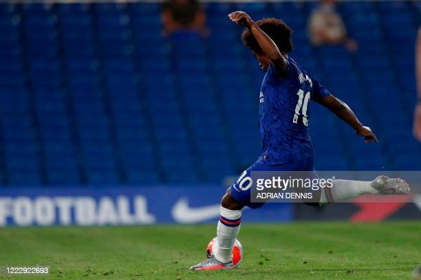 Chelsea's Brazilian midfielder Willian takes the penalty to score the team's second goal during the English Premier League football match between...