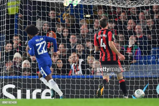 Chelsea's Brazilian midfielder Willian turns to celebrate scoring the team's first goal during the English League Cup quarterfinal football match...