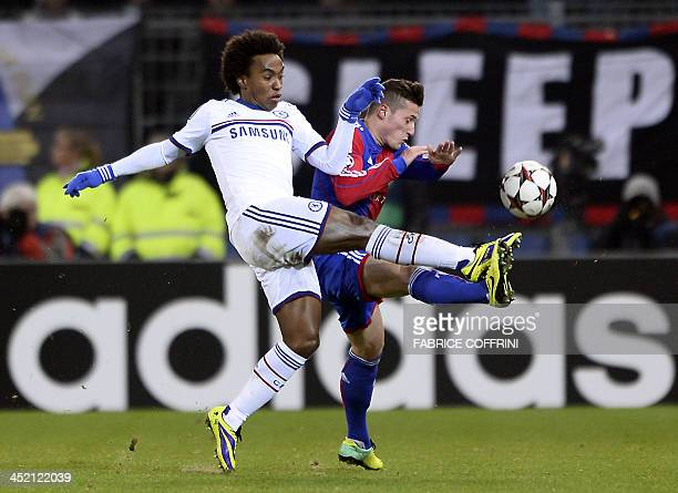Chelsea's Brazilian midfielder Willian vies for the ball with Basel's Swiss midfielder Taulant Xhaka during the UEFA Champions League group E...