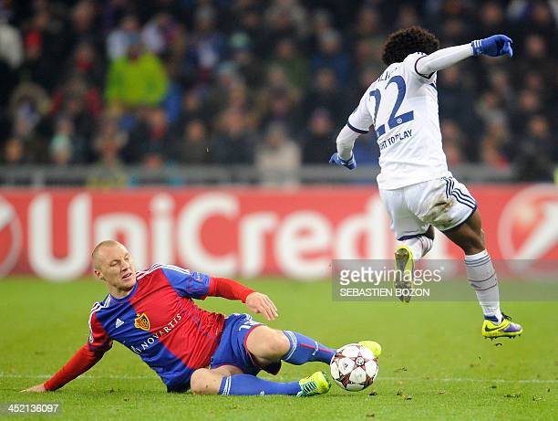 Chelsea's Brazilian midfielder Willian vies for the ball with Basel's Bulgarian defender Ivan Ivanov during the UEFA Champions League group E...