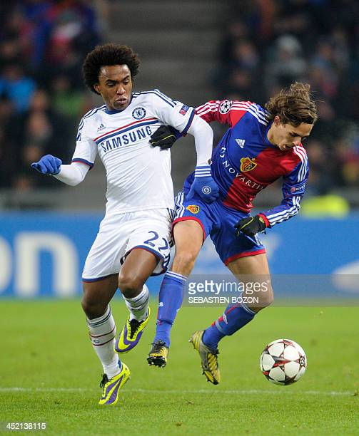 Chelsea's Brazilian midfielder Willian vies for the ball with Basel's Swiss defender Kay Voser during the UEFA Champions League group E football...