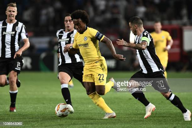 Chelsea's Brazilian midfielder Willian vies for the ball with PAOK's Greek midfielder Dimitrios Pelkas and PAOK's Portuguese midfielder Vieirinha...