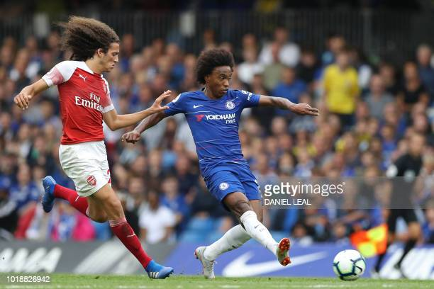 Chelsea's Brazilian midfielder Willian vies with Arsenal's French midfielder Matteo Guendouzi during the English Premier League football match...
