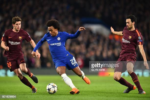 Chelsea's Brazilian midfielder Willian vies with Barcelona's Spanish midfielder Sergi Roberto and Barcelona's Spanish midfielder Sergio Busquets...