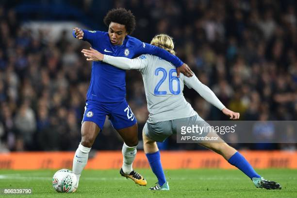 Chelsea's Brazilian midfielder Willian vies with Everton's English midfielder Tom Davies during the English League Cup fourth round football match...