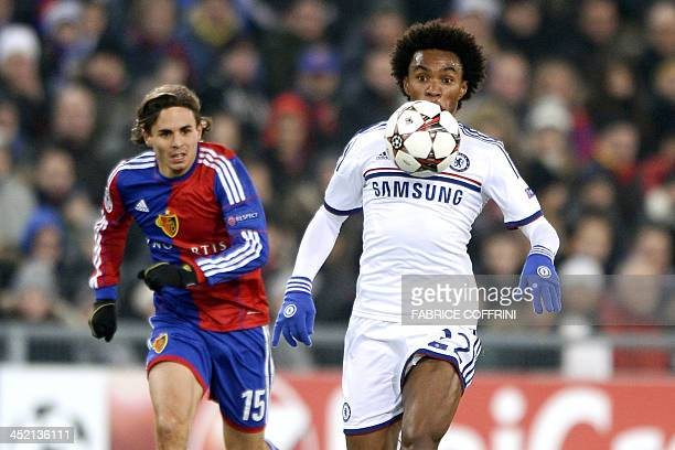 Chelsea's Brazilian midfielder Willian vies with FC Basel's defender Kay Voser during an UEFA Champions League group E football match FC Basel...