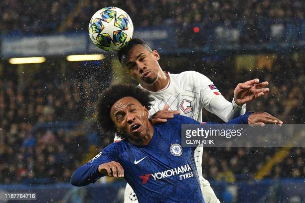 Chelsea's Brazilian midfielder Willian vies with Lille's Brazilian defender Gabriel dos Santos Magalhaes during the UEFA Champion's League Group H...