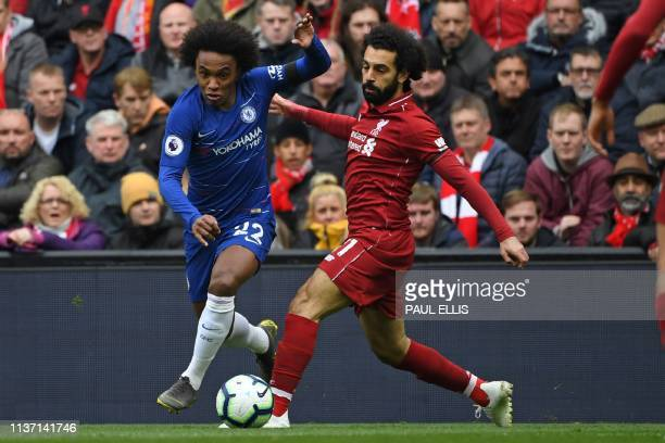 Chelsea's Brazilian midfielder Willian vies with Liverpool's Egyptian midfielder Mohamed Salah during the English Premier League football match...