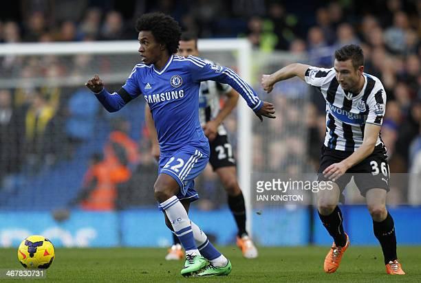 Chelsea's Brazilian midfielder Willian vies with Newcastle United's Welsh defender Paul Dummett duringthe English Premier League football match...