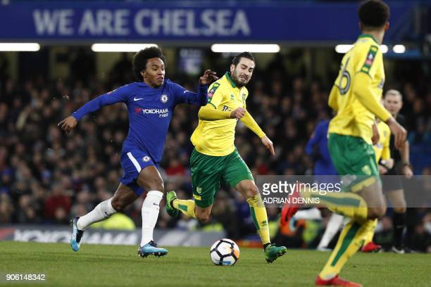 Chelsea's Brazilian midfielder Willian vies with Norwich City's Bosnian midfielder Mario Vrancic during the FA Cup third round replay football match...