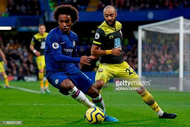 Chelsea's Brazilian midfielder Willian vies with Southampton's English midfielder Nathan Redmond during the English Premier League football match...