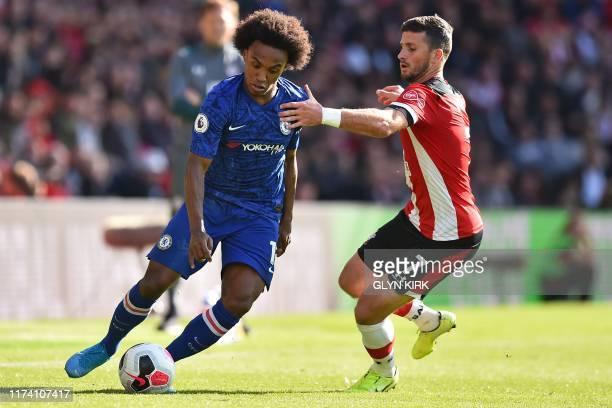 Chelsea's Brazilian midfielder Willian vies with Southampton's Irish striker Shane Long during the English Premier League football match between...