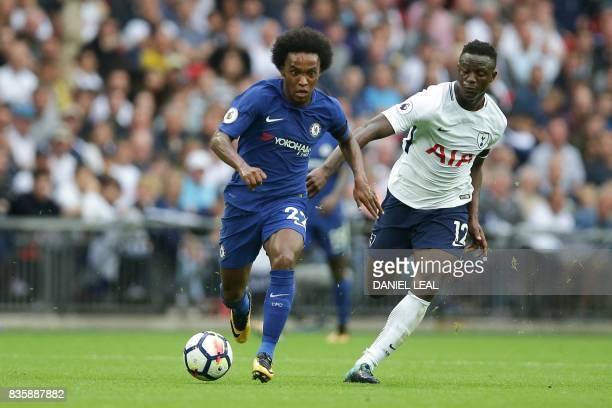 Chelsea's Brazilian midfielder Willian vies with Tottenham Hotspur's Kenyan midfielder Victor Wanyama during the English Premier League football...