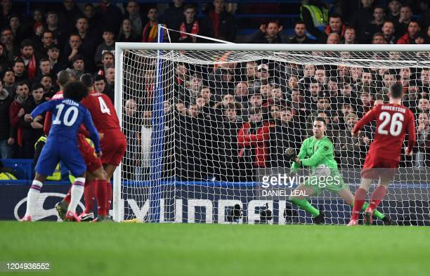 Chelsea's Brazilian midfielder Willian watches the ball as he scores the opening goal during the English FA Cup fifth round football match between...