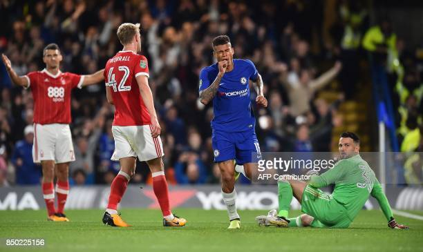 Chelsea's Brazilian striker Kenedy celebrates scoring the opening goal during the English League Cup third round football match between Chelsea and...