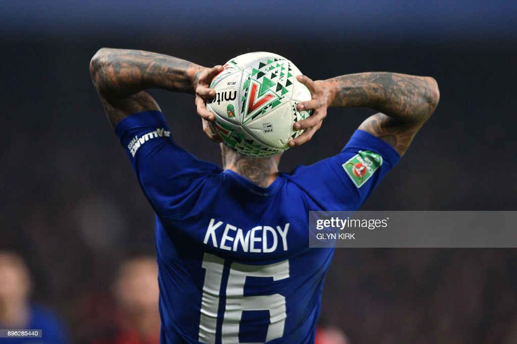 TOPSHOT - Chelsea's Brazilian striker Kenedy throws the ball in during the English League Cup quarter-final football match between Chelsea and Bournemouth at Stamford Bridge Stadium, in southwest London on December 20, 2017. / AFP PHOTO / Glyn KIRK / RESTRICTED TO EDITORIAL USE. No use with unauthorized audio, video, data, fixture lists, club/league logos or 'live' services. Online in-match use limited to 75 images, no video emulation. No use in betting, games or single club/league/player publications. /
