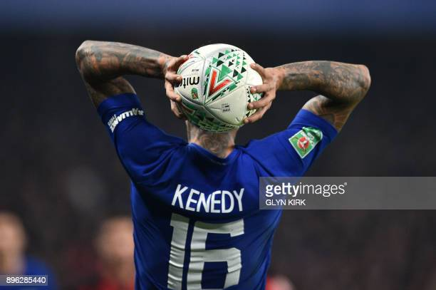 TOPSHOT Chelsea's Brazilian striker Kenedy throws the ball in during the English League Cup quarterfinal football match between Chelsea and...