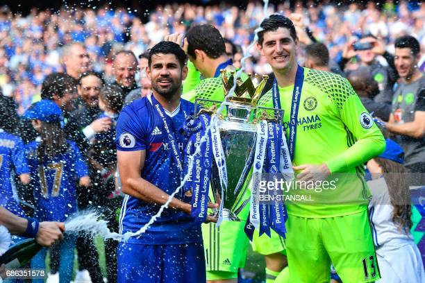 Chelsea's Brazilianborn Spanish striker Diego Costa and Chelsea's Belgian goalkeeper Thibaut Courtois hold the English Premier League trophy as...