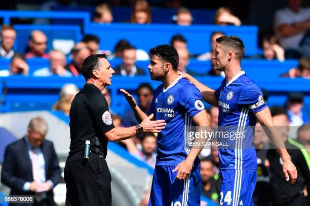 Chelsea's Brazilianborn Spanish striker Diego Costa and Chelsea's English defender Gary Cahill talk with the referee during the English Premier...