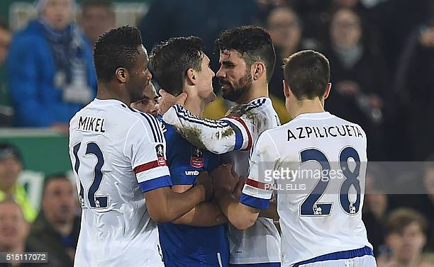 Chelsea's Brazilian-born Spanish striker Diego Costa and Everton's English midfielder Gareth Barry clash in the incident leading to Costa's second...