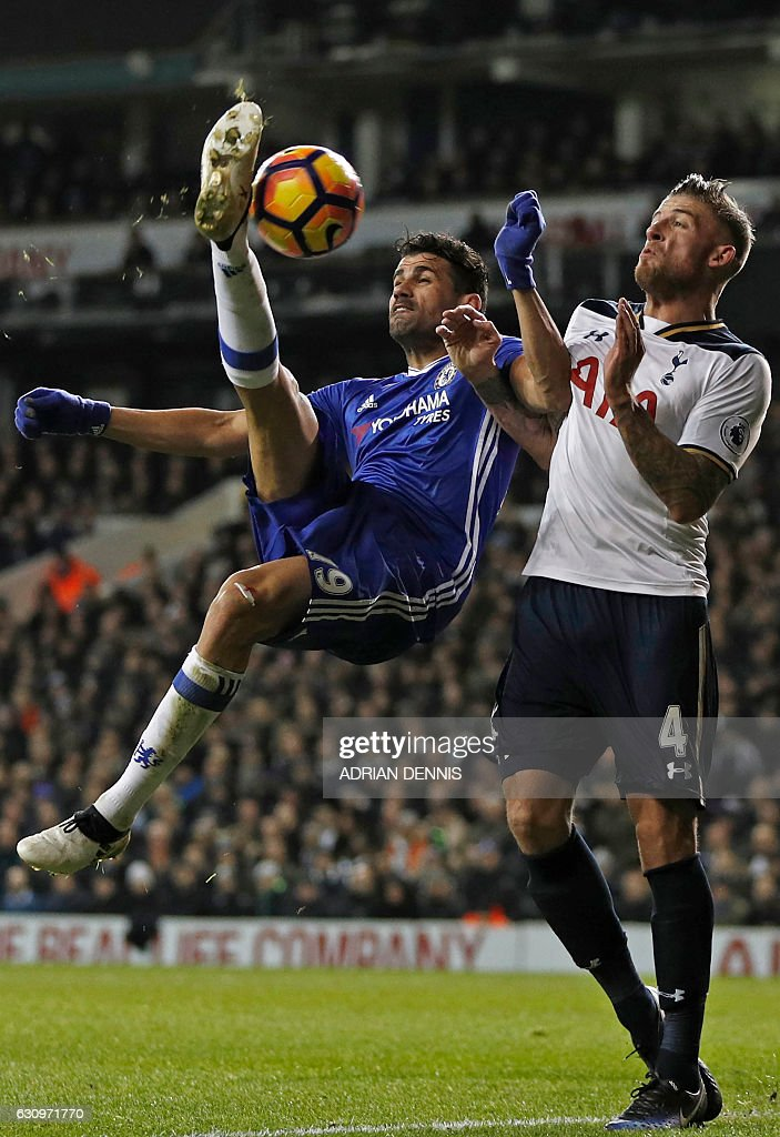 Chelsea's Brazilian-born Spanish striker Diego Costa (L) attempts a bicycle kick as Tottenham Hotspur's Belgian defender Toby Alderweireld defends during the English Premier League football match between Tottenham Hotspur and Chelsea at White Hart Lane in London, on January 4, 2017. / AFP / Adrian DENNIS / RESTRICTED TO EDITORIAL USE. No use with unauthorized audio, video, data, fixture lists, club/league logos or 'live' services. Online in-match use limited to 75 images, no video emulation. No use in betting, games or single club/league/player publications. /